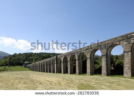Nottolini Aqueduct in Lucca - stock photo