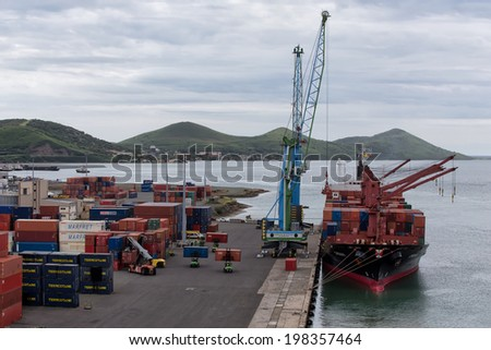 NOUMEA, NEW CALEDONIA - FEBRUARY 15, 2014: Cargo ship 'Chenan' is unloaded at the dockside. It is the main port in the region.