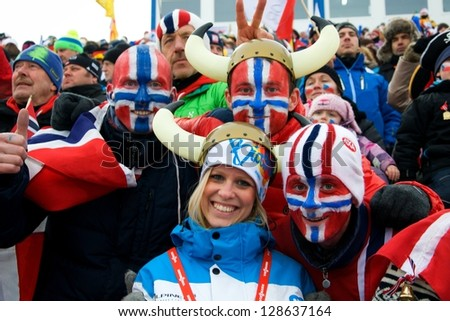 NOVE MESTO NA MORAVE - FEBRUARY 17: Volunteer with norwegian fans at IBU World Championship in biathlon 2013 in Nove Mesto na Morave 2013, February 17, Czech republic - stock photo