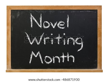 Novel Writing Month written in white chalk on a black chalkboard isolated on white