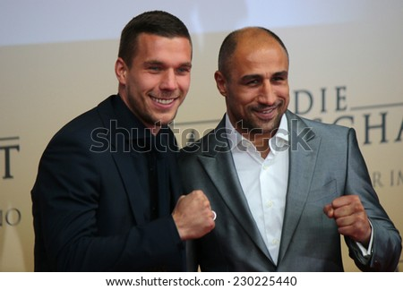 """NOVEMBER 10, 2014 - BERLIN: Lukas Podolski, Arthur Abraham - premiere of the documentary film """"Die Mannschaft"""" (the team) about the win of the football world cup 2014, Sony Center, Berlin. - stock photo"""
