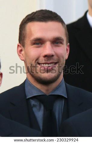 NOVEMBER 10, 2014 - BERLIN: Lukas Podolski - official reception of the German national football team (world champion 2014) at the Schloss Bellevue. - stock photo