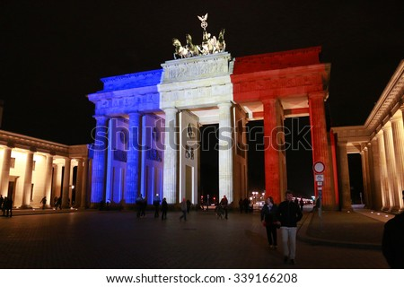 NOVEMBER 14, 2015 - BERLIN: the Brandenburg Gate in the colors of France -  mourning at the French Embassy in Berlin for the victims of the massacres in Paris of November 13, 2015. - stock photo