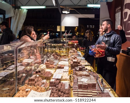 NOVEMBER 17, 2016 - BOLOGNA, ITALY - Thousands of people gather around the Piazza Maggiore at the center of Bologna for the Cioccoshow 2016. One of the most important chocolate fairs in Italy.