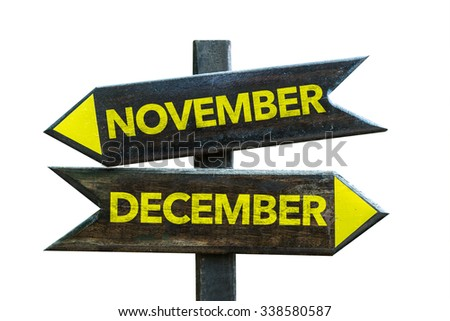 November December signpost isolated on white background