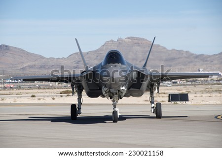 November 2014. Nellis AFB, Las Vegas, Nevada, USA. Lockheed Martin F-35A Lightning II stealthy supersonic jet fighter aircraft. Low visability, high technology and futuristic design. - stock photo