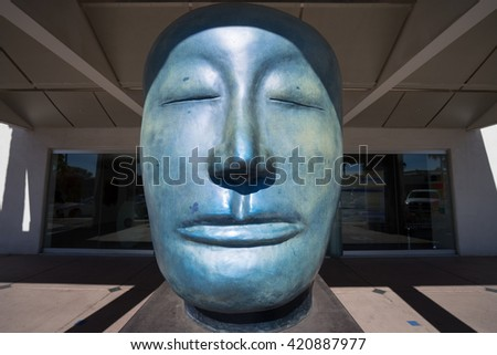 November 30, 2015 Old Scottsdale, Arizona, USA: giant statue of a head is exhibited on the street of the historical town on the art-walk