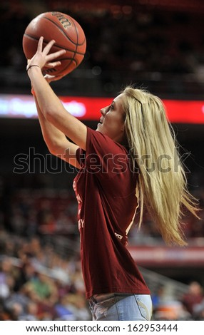 NOVEMBER 11 - PHILADELPHIA: A Temple student competes in an on-court contest during the NCAA basketball game against Kent State November 11, 2013 in Philadelphia  - stock photo