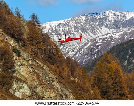 November 2014 - SWISS ALPS: a Helicopter near St.Moritz, Swiss Alps. - stock photo