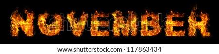 November text on fire - stock photo