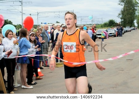 NOVGOROD REGION, RUSSIA - AUGUST 25: Unknown athletes-runners participate in athletics cross during a holiday in rural settlement Bolshaya Vishera, Novgorod region, Russia. August 25, 2009.