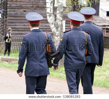 NOVGOROD REGION, RUSSIA - MAY 9: Unknown police carries raid on protection public order on streets rural settlement Bolshaya Vishera,  Novgorod region, Russia. May 9, 2010. Carried annually.