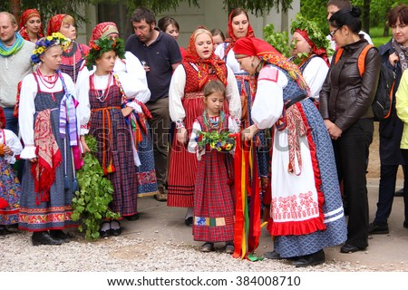 """Novgorod, RUSSIA - May 31 2015, Reconstruction of the ancient Slavic pagan rites """"spike"""" / """"walking spikelets."""" Girls and women in Russian traditional clothing, Trinity festivities"""". - stock photo"""