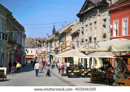 NOVI SAD, SERBIA - APRIL 03: Dunavska Street is one the oldest streets in center of Novi Sad, this street is a pedestrian zone, with pubs, restaurants, boutique... in Novi Sad, Serbia on April 03,2016 - stock photo