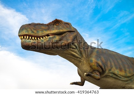 NOVI SAD, SERBIA - APRIL 28, 2016: Tyrannosaurus rex model of prehistoric animal in dinosaurus theme entertainment park. T-rex was one of the largest land carnivores of all time.