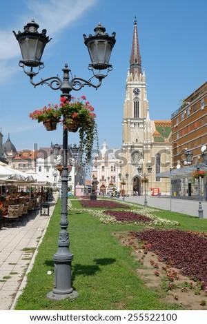 NOVI SAD, SERBIA - AUGUST 03: old style street light and the Catholic Cathedral in main square of Novi Sad. Shot in 2014  - stock photo