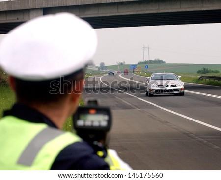 NOVI SAD, SERBIA - CIRCA MAY 2006: Policeman controls speed at E-75 highway circa May 2006 in Novi Sad - stock photo