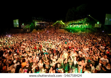 NOVI SAD, SERBIA - JULY 11: Audience in front of the Dance Arena at EXIT 2013 Music Festival, during Fat Boy Slim's performance on July 11, 2013 in the Petrovaradin Fortress in Novi Sad. - stock photo