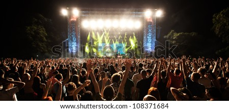 NOVI SAD, SERBIA - JULY 12: Audience in front of the Main Stage at EXIT 2012 Music Festival, during Skindred's performance on July 12, 2012 in the Petrovaradin Fortress in Novi Sad. - stock photo