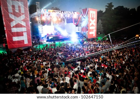 NOVI SAD, SERBIA - JULY 7: Audience infront of the Dance Arena at EXIT 2011 Music Festival, during DEADMAUS5 performance on July 7, 2011 in the Petrovaradin Fortress in Novi Sad. - stock photo