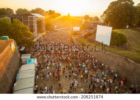 NOVI SAD, SERBIA - JULY 12: Audience infront of the Dance Arena on sunrise, at EXIT 2014 Music Festival, on July 12, 2014 in the Petrovaradin Fortress in Novi Sad.  - stock photo