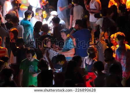 NOVI SAD, SERBIA - JULY 13: Crowd enjoying silent disco stage at Exit festival on July 13, 2014 in Petrovaradin fortress - stock photo