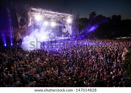 NOVI SAD, SERBIA - JULY 13: Crowd in front of the Dance Arena at EXIT 2013 Music Festival, during Steve Angelo's performance on July 13, 2013 in the Petrovaradin Fortress in Novi Sad. - stock photo