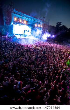 NOVI SAD, SERBIA - JULY 13: Crowd in front of the Dance Arena at EXIT 2013 Music Festival, during Steve Angelo's performance on July 13, 2013 in the Petrovaradin Fortress in Novi Sad.