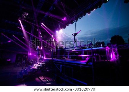 NOVI SAD, SERBIA - JULY 11 2015: Festival acrobat performer during DJ MK performance at EXIT 2015 Music Festival, on July 11, 2015 at the Petrovaradin Fortress in Novi Sad, Serbia. - stock photo