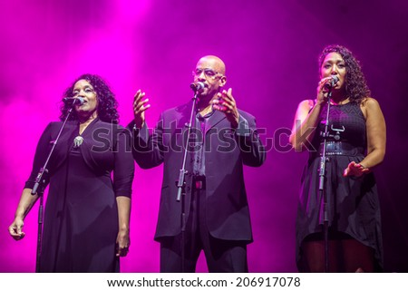 NOVI SAD, SERBIA - JULY 11: Gloria Gaynor's supporting vocals perform at EXIT 2014 Best Major European Music Festival, on July 11, 2014 at the Petrovaradin Fortress in Novi Sad, Serbia. - stock photo
