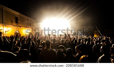 NOVI SAD, SERBIA - JULY 13: Silhouettes of the crowd infront of the Huawei Fusion Stage at EXIT 2014 Music Festival, on July 13, 2014 in the Petrovaradin Fortress in Novi Sad.   - stock photo