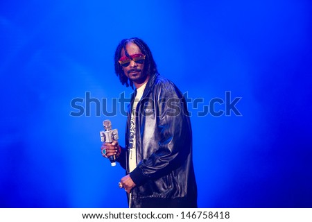 NOVI SAD, SERBIA - JULY 11: Snoop Dogg aka Snoop Lion performs at EXIT 2013 Music Festival, on July 11, 2013 at the Petrovaradin Fortress  in Novi Sad, Serbia. - stock photo