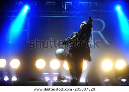 NOVI SAD, SERBIA - JULY 13, 2014: Theo Hutchcraft, singer of Hurts (band), performs  live at the Best European Music Festival - EXIT 2014 at the Petrovaradin Fortress in Novi Sad - stock photo
