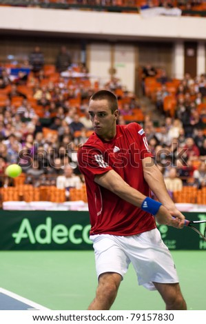 NOVI SAD, SERBIA - MAR 6 : Serbia tennis player, singles ranking 12 Viktor Troicki during his Davis Cup, 2011 World Group singles match vs. Somdev Devvarman, March 6, 2011 in Novi Sad, Serbia - stock photo