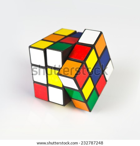 NOVI SAD, SERBIA - NOVEMBER 17, 2014: Rubik's Cube invented by a Hungarian architect Erno Rubik in 1974 is famous 3 dimensional puzzle originally called Magic Cube. Selective focus with soft shadow. - stock photo