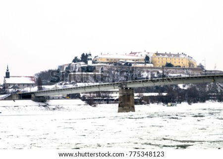 Novi Sad, Serbia, The Old Military Petrovaradin Fortress And The Frozen  Danube River After