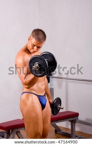 novice bodybuilder training his bicep - stock photo