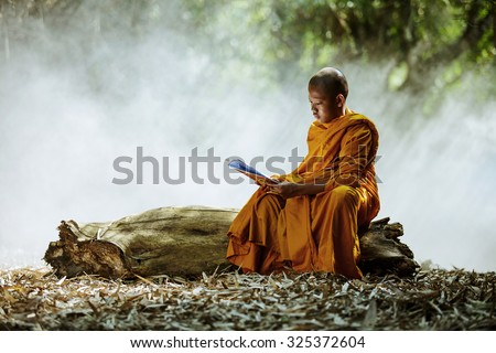 Novice monk learning in the Thailand. - stock photo