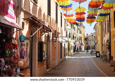 NOVIGRAD, CROATIA - AUGUST 31, 2017: Narrow winding street in Novigrad. Novigrad is a small Istrian coastal town with narrow winding streets; small shops and pleasant cafes.