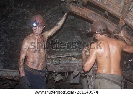 "Novogrodovka, Ukraine - January, 18, 2013: Miners construct overlap at the coal face at a depth of 800 meters. The mine ""1/3 Novogrodovskaya"" - stock photo"
