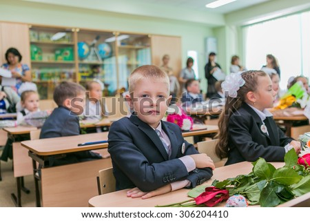 NOVOKUZNETSK, KEMEROVO REGION, RUSSIA - SEPTEMBER, 1, 2014: First-grade students and teacher are in school classroom at first lesson. The day of knowledge in Russia.