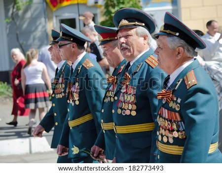 Novomoskovsk Dnipropetrovsk region. Ukraine - May 9: Victory Day holiday, veterans with medals are on the streets of the city , Novomoskovsk Dnipropetrovsk region May 9, 2013