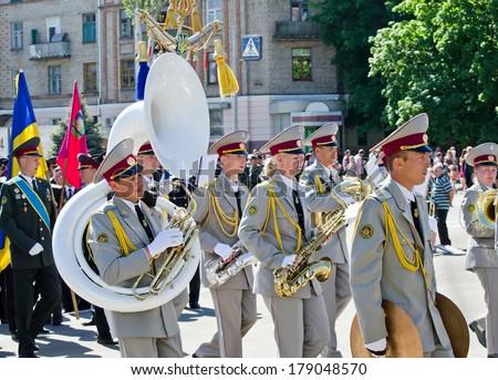 NOVOMOSKOVSK DNIPROPETROVSK, UKRAINE -  MAY 9: Victory Day holiday,  military brass band, Novomoskovsk Dnipropetrovsk region May 9, 2013  - stock photo