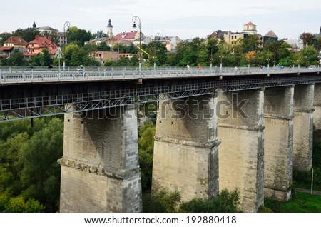 Novoplanovsky bridge is the youngest bridge in the Ukrainian town Kamianets-Podolsky. - stock photo
