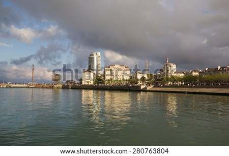 NOVOROSSIYSK, RUSSIA, MAY 9, 2015: The waterfront lit by the setting sun - stock photo