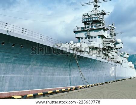 """NOVOROSSIYSK, RUSSIA, 19 October 2014: Artillery cruiser """"Mikhail Kutuzov"""" in the port of Novorossiysk, 19 October 2014. - stock photo"""