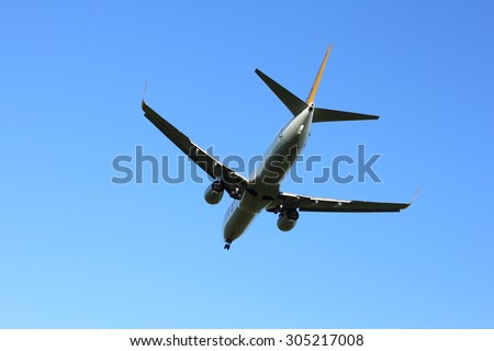 NOVOSIBIRSK - AUGUST 09: Boeing 737-800 operated byPegasus, approaches at Novosibirsk Tolmachevo Airport morning landing blue sky. August 09, 2015 in Novosibirsk Russia - stock photo