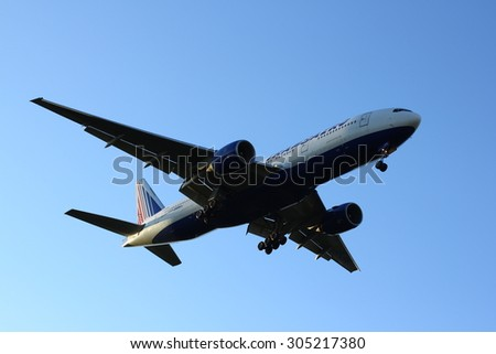 NOVOSIBIRSK - AUGUST 09: Boeing 777-200 Transaero Airlines approaches at Novosibirsk Tolmachevo Airport morning landing blue sky background. August 09, 2015 in Novosibirsk Russia