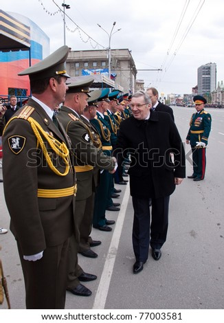 NOVOSIBIRSK - MAY 9: Viktor Tolokonskiy presidential envoy to the Siberian Federal District, congratulates the commander on parade dedicated victory in World War II on May 9, 2011, Novosibirsk Russia