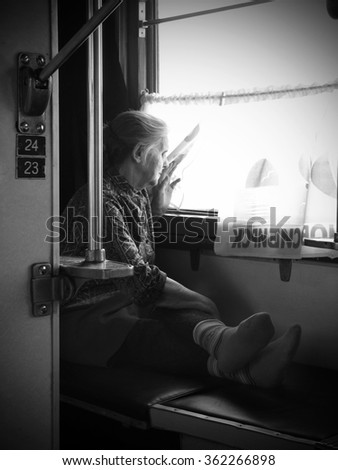 NOVOSIBIRSK: NOVEMBER 10th: An adult woman sitting in train, on November 10th, 2005, in Novosibirsk, Russia.